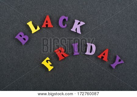word on black board background composed from colorful abc alphabet block wooden letters copy space for ad text. Learning english concept