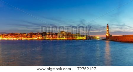 Panorama venetian harbour waterfront and Lighthouse in old harbour of Chania during twilight blue hour, Crete, Greece