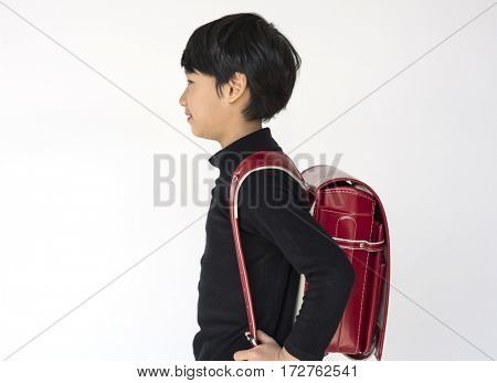 Little cute and adorable student boy is back to school