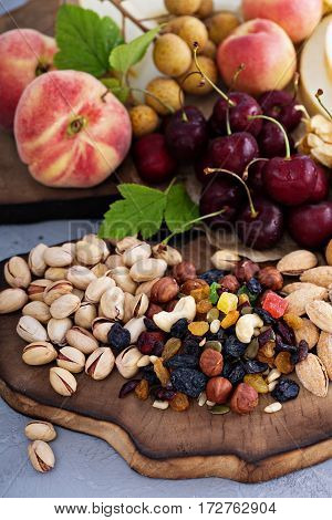 Fresh fruit and nut platter with cherry, peaches and trail mix