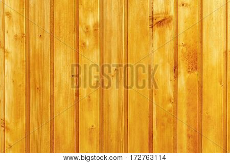 background texture of a wall lined with wooden planks painted with varnish