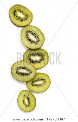 Slices of kiwi fruit top view  isolated on white.