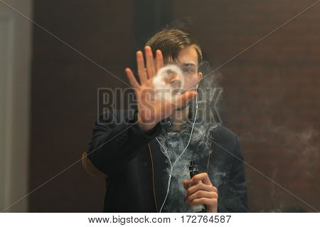 Young Handsome White Guy Let Rings Out Of Steam. Vaping.