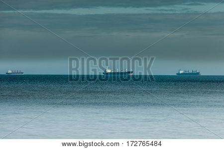 Transportation cargo conteiner ships sailing in still water heading for the port