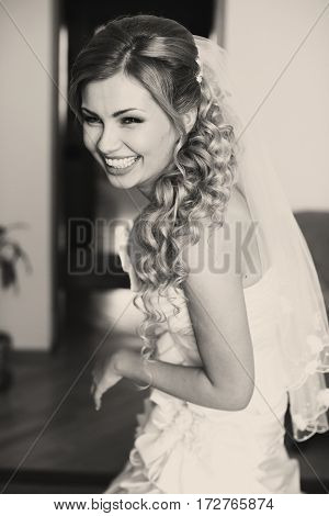 Blonde Bride With Long Hair Laughs While Posing In The Hotel