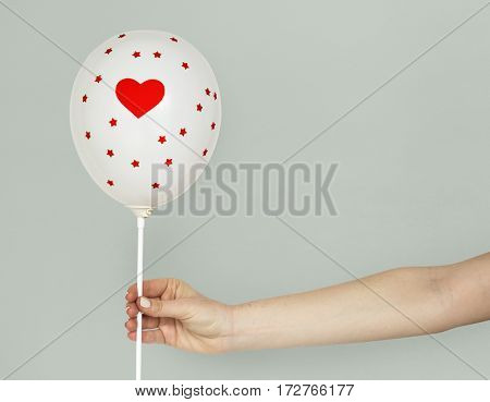 Hands Holding Balloon Heart Decoration
