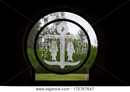 GALILEE ISRAEL - DECEMBER 3: The Round window with anchor and fish symbols above the entrance in Domus Galilaeae on the Mount of Beatitudes near the Sea of Galilee Israel on December 3 2016