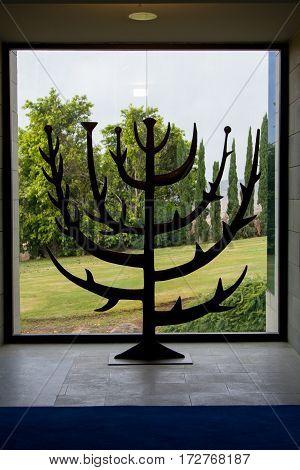 GALILEE ISRAEL - DECEMBER 3: The Burning bush sculpture burning bush menorah in Domus Galilaeae on the Mount of Beatitudes near the Sea of Galilee Israel on December 3 2016