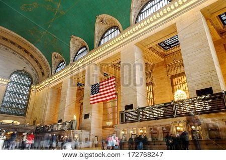 New York February 21 2017: People walk in Grand Central's main councourse long exposure blurred view.