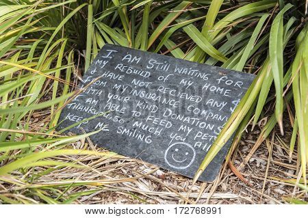 Christchurch New Zealand - February 2016: A message board written by an earthquake victim urging for home rebuilding