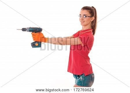 young cheerful brunette woman builder in uniform with glasses and drill in her hands make reovations isolated on white