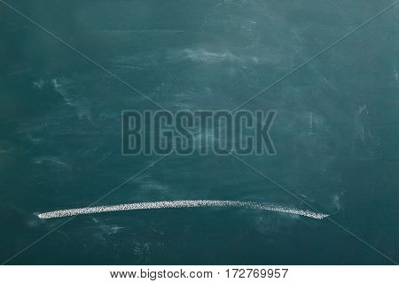 Green chalkboard with white chalk line drawn on it
