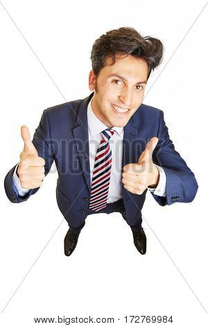 Grining business man cheering and holding both thumbs up