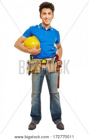 Smiling handyman standing with hardhat and tool belt