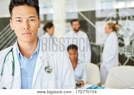Young asian man as doctor with interracial and competent team