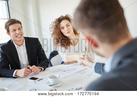 Business people during negotiation finding an agreement for partnership