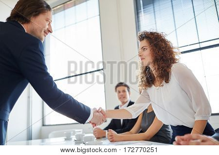 Business people shaking hands as partners in start-up