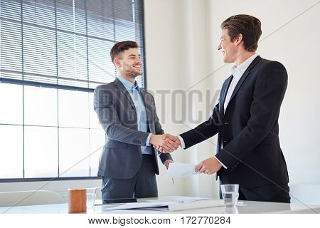 Handshake between to business people as sign of partnership