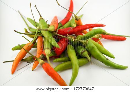 Chili take with white background.It have rawmiddleripe chili so beauty color.