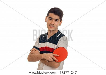 beautiful sportsman practicing a table tennis with racket in hands and looking at the camera isolated on white