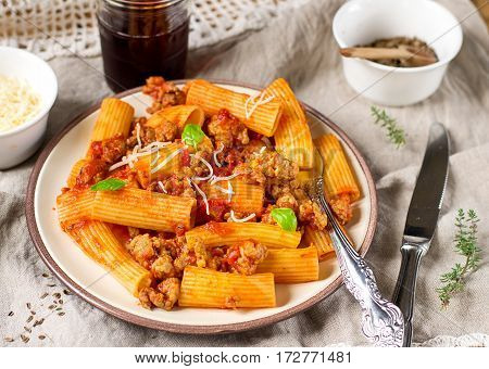 Pasta rigatoni in bolognese sauce with ground meat and tomato