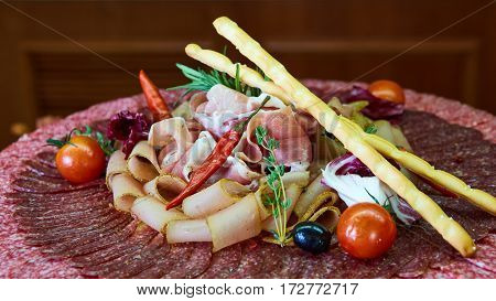 Assorted meats and sausages, olives and spices, close-up