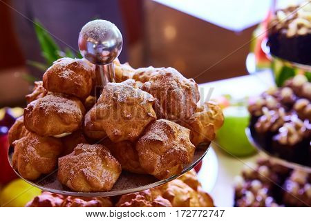 The fresh homemade profiteroles with cream pastry