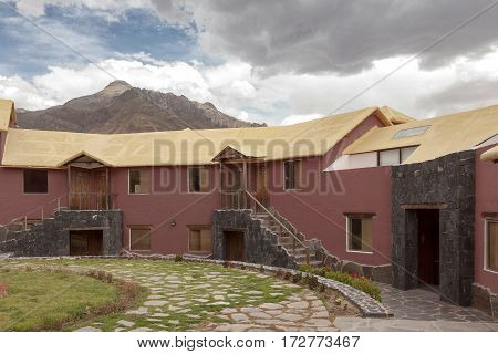 A Traditional Vintage Hotel In Chivay, Arequipa Peru With Clouds