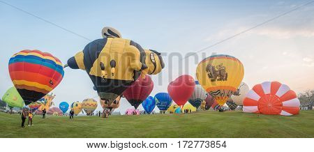Chiang Rai, Thailand - February 14 2017: Singha Park Chiang Rai Balloon Fiesta 2017. This festival is ASEAN's biggest balloon festival, the event is part of Thailand's 2017 Valentine's celebrations. Panorama view.