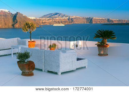 White terrace with sea view in Oia or Ia, Aegean island, Santorini, Greece