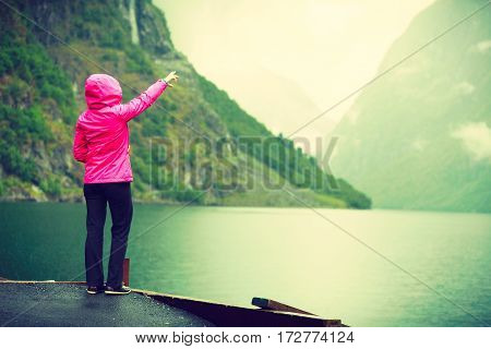 Tourist Looking At Mountains And Fjord Norway, Scandinavia.