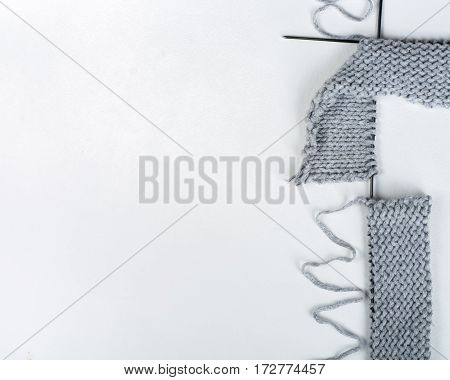 Knitted sweaters with knitting needles and wool hendmade