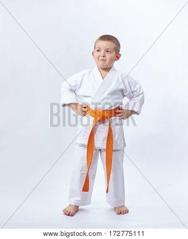 Karateka with orange belt on white background