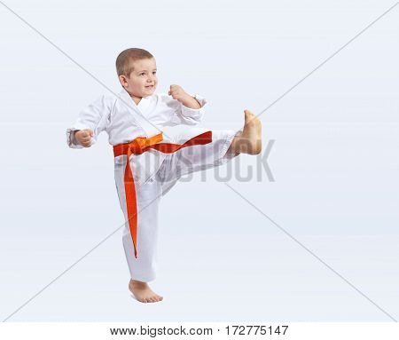 Sportsman is beating kicking on a white background