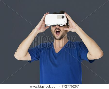 A man using a visualiaing reality gadget
