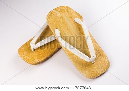 Japanese bamboo slippers are on white background.