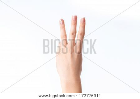 female hand showing three fingers isolated on white
