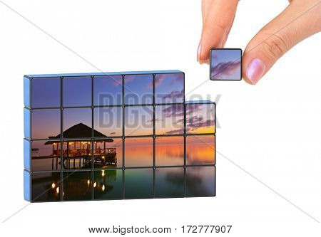 Hand and Maldives puzzle (my photo) isolated on white background