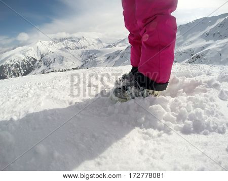 Skiing shoes on snow- body part