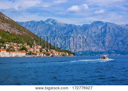 Village Perast on coast of Boka Kotor bay - Montenegro - nature and architecture background
