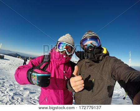 Young couple happy together on skiing