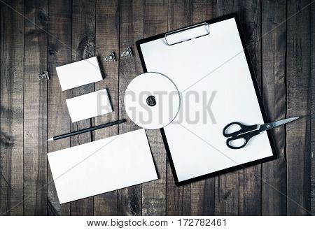 Blank stationery and corporate identity template on vintage wooden background. Responsive design mock up. Blank objects for placing your design. Top view.