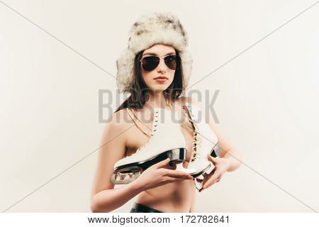 Young Woman With Ice Skates. Winter Style