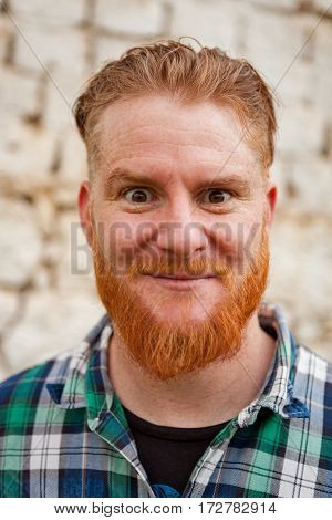 Portrait of a red haired man in a rural enviroment