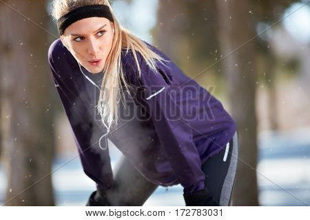 Breathless girl make short break from running
