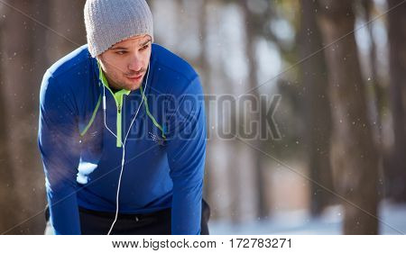 Breathless sportsman stop running on training outdoor