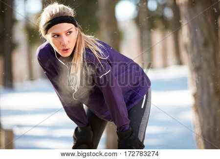 Athlete female stopped running to rest