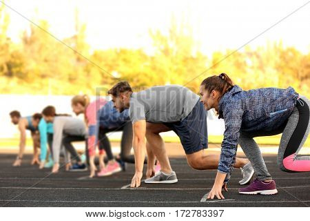 Sportsmen preparing to run at stadium