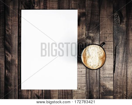 Blank letterhead and coffee cup on vintage wooden table background. Blank branding template. Blank stationery. Mockup for branding identity for placing your design. Top view.. Top view.