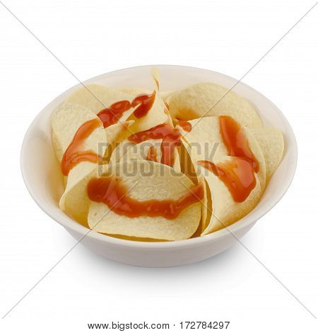 side view of round potato chips in a white round shaped ceramic bowl dipped with ketchup sauce isolated background